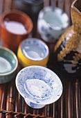 Sake in small bowls