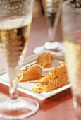 Salmon rolls and champagne glasses