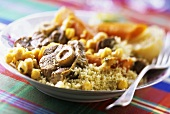 Leg of lamb with couscous and chick-peas