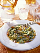 Mussel soup with vegetables and pesto