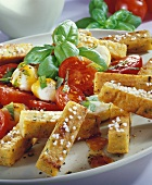 Chick-pea chips with tomatoes, mozzarella and basil