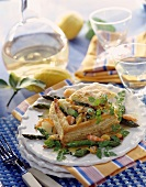 Puff pastry case filled with seafood and asparagus