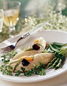 Cold chicken breast in jelly with green asparagus
