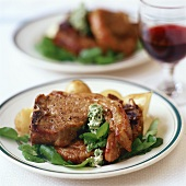 Lamb chops with herb butter and watercress