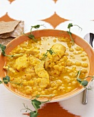 Chick-pea soup with saffron chicken