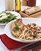 Chicken breast with spaghetti and chopped almonds