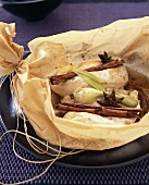 Chicken breast with cinnamon sticks & star anise in baking paper