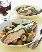 Salmon fillet with spinach sauce on potato salad
