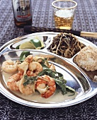 Shrimps in coconut sauce with seaweed salad (Asia)