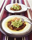 Potato rosti with avocado puree and crab tails
