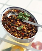 Chili con carne with fresh basil