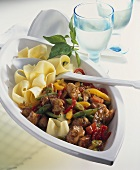 Spicy pork and pepper ragout with ribbon pasta