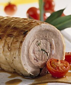 Roast pork roll with tomatoes