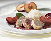 Pork fillet in juniper sauce with plums and rice