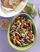 Squid salad with cherry tomatoes and basil