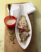 Fried sea bream fillet with coconut sauce