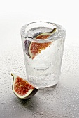Ice glass with vodka and figs