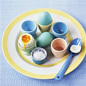 Soft-boiled coloured eggs in eggcups for Easter