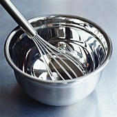 Whisk in stainless steel bowl
