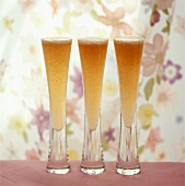 Three glasses of Bellini (sparkling wine with peach juice)