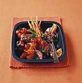 Grilled pork medallions with vegetables and oranges