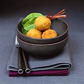 Potato croquettes in bowl on fabric napkins
