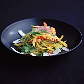 Papaya salad with coconut, onions and chilli rings