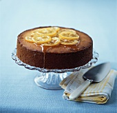 Lemon polenta cake on cake stand