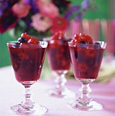Berry compote in three glasses on table in the open air
