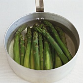 Green asparagus in a pan