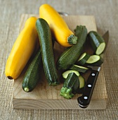 Yellow and green courgettes, partly sliced