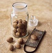 Nutmegs in a jar and on a grater