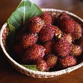Several rambutans in a basket