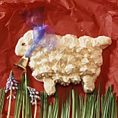 Sweet Easter lamb made of meringue with bow and bell