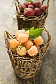 Yellow and red raspberries in two small baskets