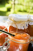 Nectarine jam in jars on table in the open air