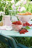 Apricots, berries and jam jars on garden table