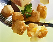 Fried cheese cubes in wine batter