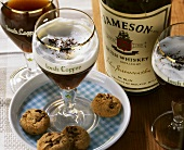 Irish Coffee with whiskey and cream in a glass