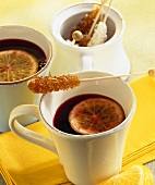 Elderberry punch with slices of lemon & sugar swizzle sticks