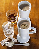 Hot chocolate with almonds and amaretto, packets of sugar