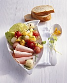 Savoury melon and pineapple salad with smoked, cured pork