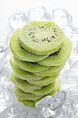 Frozen kiwi fruit slices (in a pile) on ice cubes