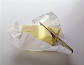 Butter in paper with knife