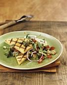 Grilled polenta slices with summer vegetables