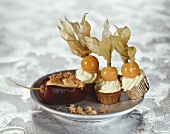 Stuffed date and sweets topped with physalis