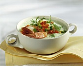 Cold cucumber soup with shrimps and diced peppers