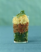 Beef tartare with parsley salad & truffled egg in a glass