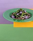 Beetroot salad with purslane and borage flowers