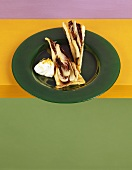 Two slices of radicchio tart on green plate